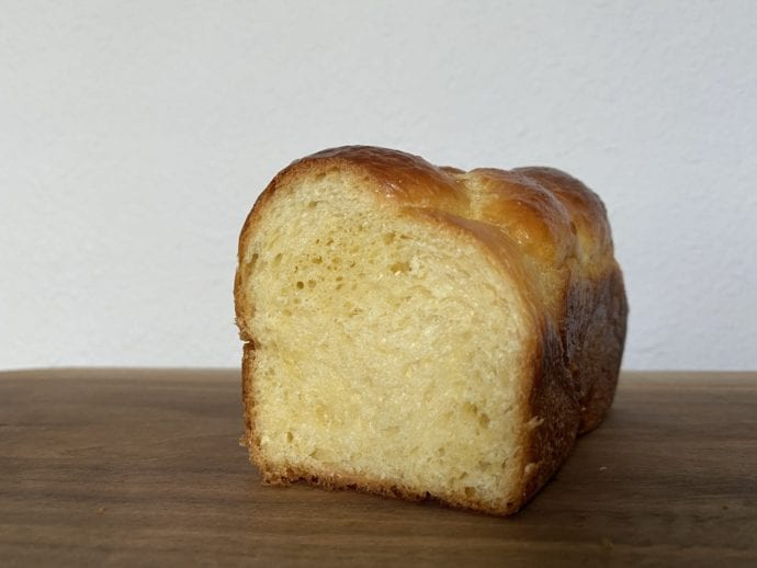 Brioche loaf cut to show an airy crumb.