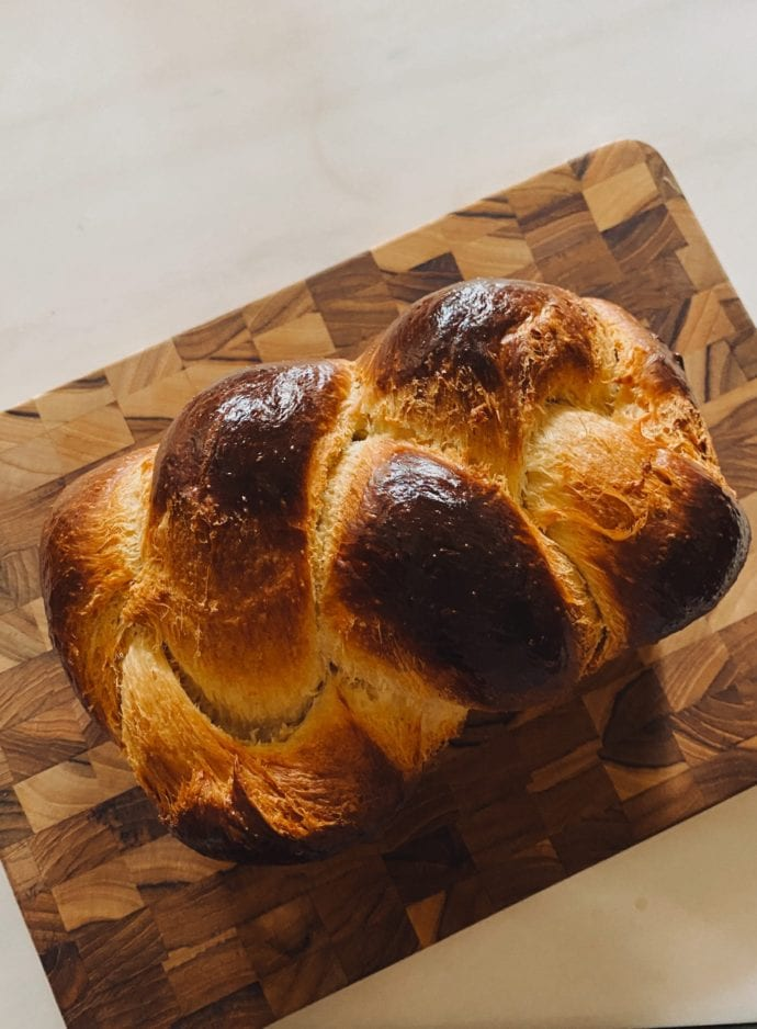 Braided brioche loaf shot from above