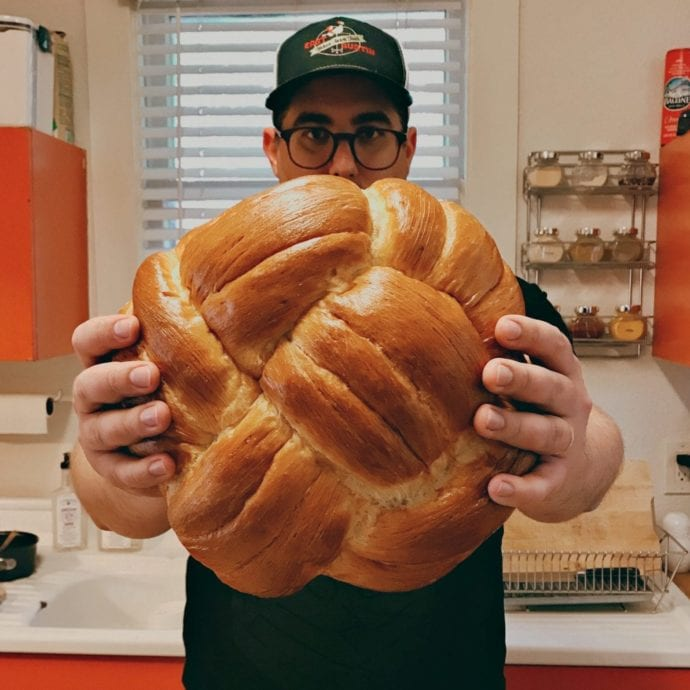 Joel holding a giant braided challah