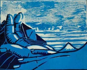 Woodcut print of hand and landscape by student